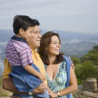 Hispanic family hugging — Stock Photo