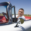 Hispanic mdriving convertible — Stock Photo #23322282