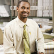 African American businessman in flooring store — Stock Photo