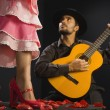 Hispanic female flamenco dancer next to guitar player — Stok Fotoğraf #23322360