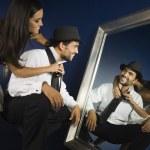 Hispanic woman tying husband's tie — Stock Photo #23322402