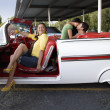 Hispanic womsitting in convertible — Stock Photo #23322406