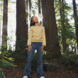 Stock Photo: Asigirl standing in woods