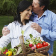 Hispanic couple with basket of vegetables — Stock Photo #23322652