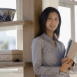 Asian businesswoman looking holding folders — Stock Photo