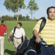 Multi-ethnic men on golf course — Stock Photo #23322868