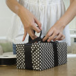 Asian woman wrapping gift — Stock Photo #23322906