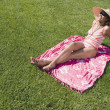 Mixed Race woman sunbathing — Stock Photo