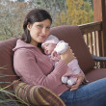 Hispanic mother hugging baby — Stock Photo #23323080