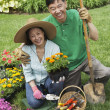 Senior Asian couple gardening — Stock Photo