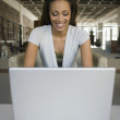 African American woman looking at laptop — Stock Photo