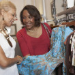 Stock Photo: Senior AfricAmericwomen clothes shopping