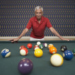 Stock Photo: Senior mleaning on pool table