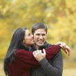 Stock Photo: Multi-ethnic couple hugging