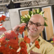 Hispanic male florist talking on telephone — Stock Photo
