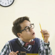 Nerdy Asian man sharpening pencil — Stock Photo