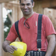 Mixed Race male construction worker holding hard hat — 图库照片