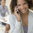 African businesswoman talking on cell phone — Stock Photo