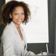 Africbusinesswomat conference table — Stock Photo #23323796