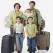 Portrait of multi-ethnic family with suitcases — Stock Photo