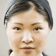 Close up of Asian woman wearing headband — Stock Photo
