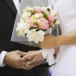 Stock Photo: Close up of bride holding bouquet