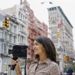Mixed Race womholding video camera — Stock Photo #23323896