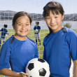 Multi-ethnic girls with soccer ball — Stock Photo