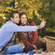 Hispanic couple taking own photograph — Stock Photo #23324022