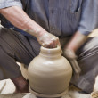Senior Hispanic man making pottery — Stock Photo
