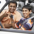 Middle Eastern father and son in new car — Stock Photo