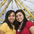 Multi-ethnic teenaged girls at carnival — Stock Photo #23324200