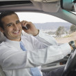 Hispanic businessmtalking on cell phone — Stock Photo #23324208