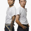 Two Asian men in rockabilly clothing — Stock Photo