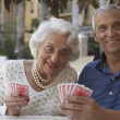Senior couple playing cards — Stock Photo