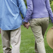 Hispanic couple holding hands — Stock Photo
