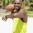 African American man throwing football — Stock Photo