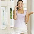 Stock Photo: Hispanic womtalking on telephone