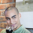 African American man drinking wine — Stock Photo