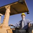 Stock Photo: Businessmin hard hat on construction site
