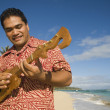 Pacific Islander man playing instrument at beach — Stock Photo