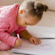 African girl drawing in notebook — Stok fotoğraf