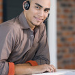 African American businessman wearing headset — Stock Photo