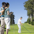 Stock Photo: Senior Asiwomplaying golf