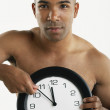 African American man holding clock — Stock Photo