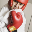 Asian businessman in boxing gear — Stock Photo