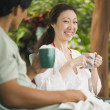 Stock Photo: Asian couple drinking coffee