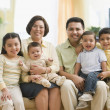 Stock Photo: Multi-ethnic family on sofa