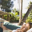 Asian woman laying in hammock — Stock Photo