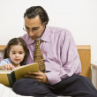 Father and daughter reading — Stock Photo